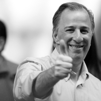 FILE PHOTO: Jose Antonio Meade, presidential pre-candidate for the Institutional Revolutionary Party (PRI), gestures to supporters during a political event in Mexico City, Mexico January 14, 2018. REUTERS/Daniel Becerril/File Photo