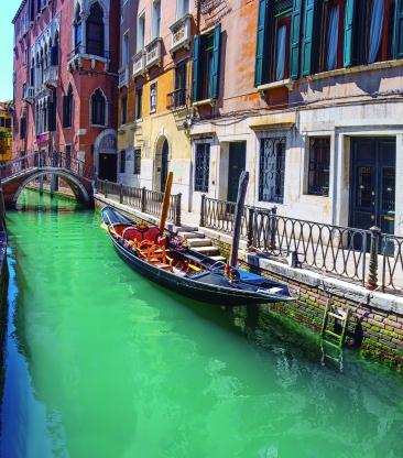 Gondola, old buildings and Devil's Bridge in central Venice, Italy